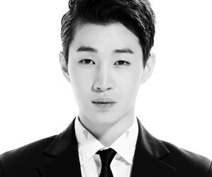 "Super Junior's Henry ""Swings"" promotional picture."