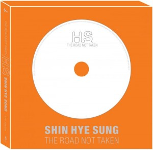 "Album art for Shin Hye-Sung (Shinhwa)'s album ""The Road Not Taken"""