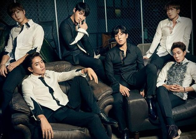 "Shinhwa's ""Unchanging Pt. 2 Touch"" promotional picture."