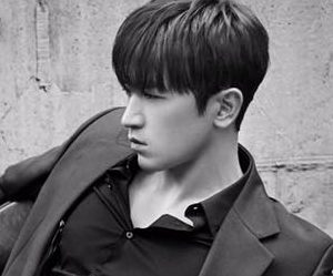 "Shinhwa's Minwoo ""Unchanging Pt. 2 Touch"" promotional picture."
